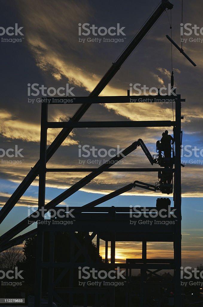 Silhouette of Construction Steel Erectors stock photo