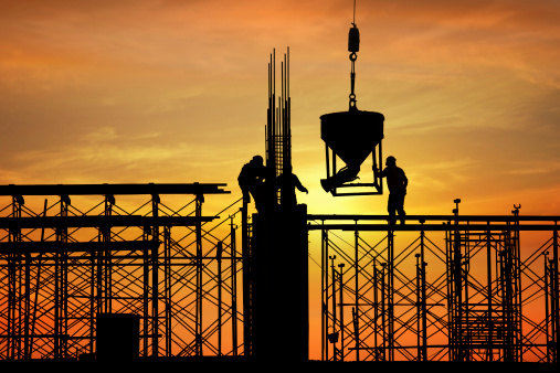 Silhouette Of Construction Worker On Construction Site Stock Photo - Download Image Now