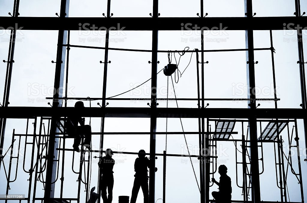 Silhouette of Construction Workers installing Windows stock photo