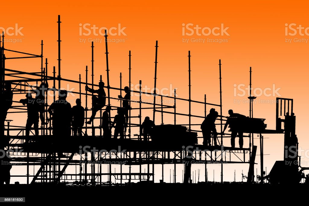 Silhouette of construction workers working on scaffolding with twilight sky stock photo