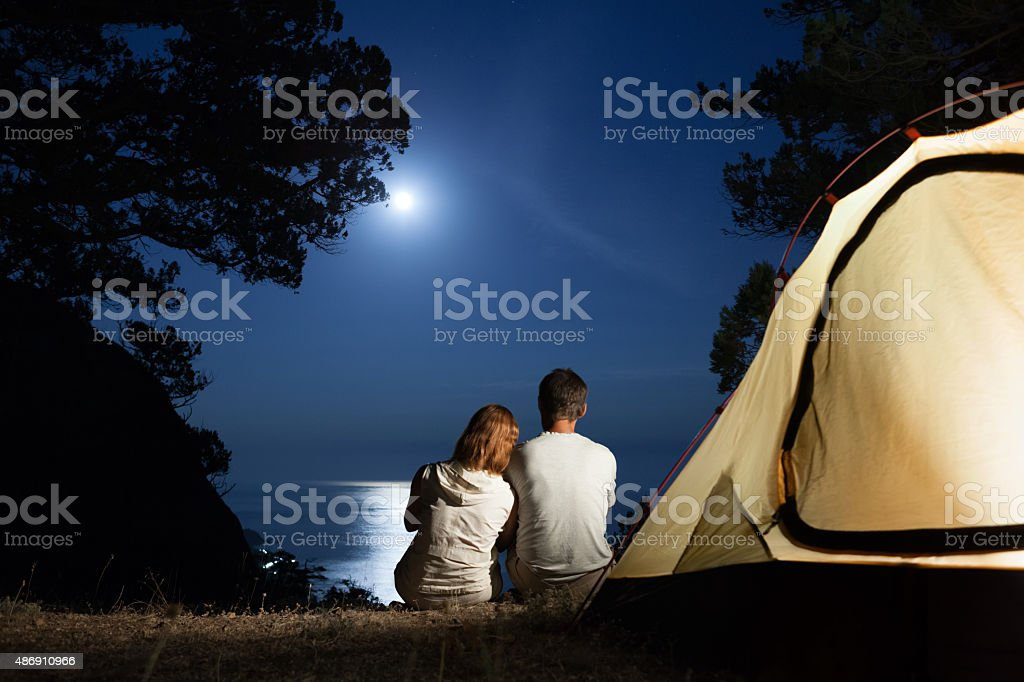Silhouette of couple at moon night stock photo