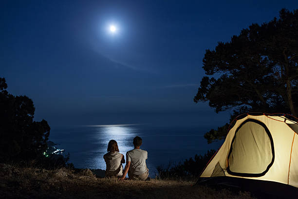 Silhouette of couple at night stock photo