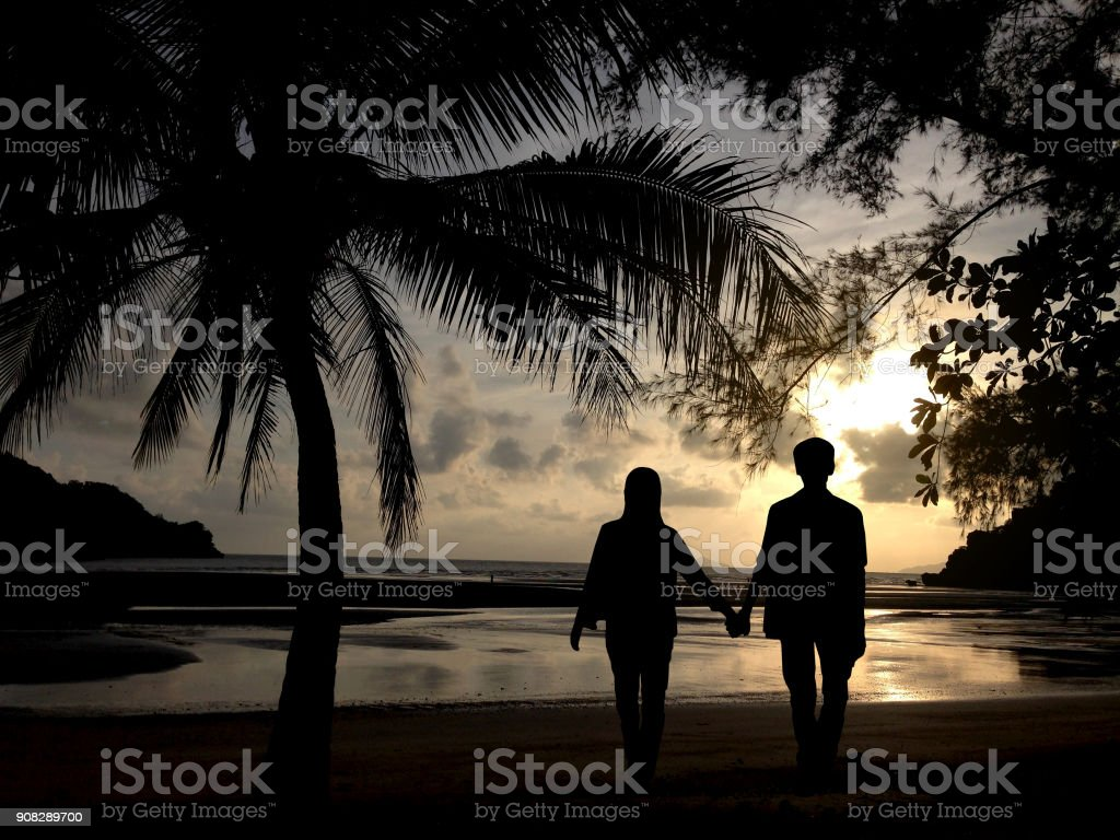 Silhouette of couple man and woman stock photo