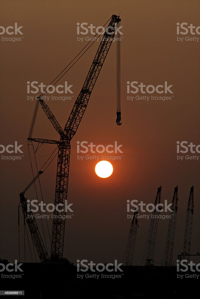 Silhouette of Crane in sunsets. stock photo