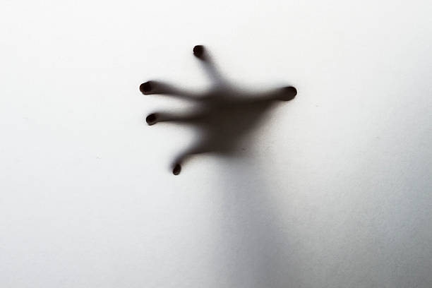 Silhouette of creepy hand stock photo