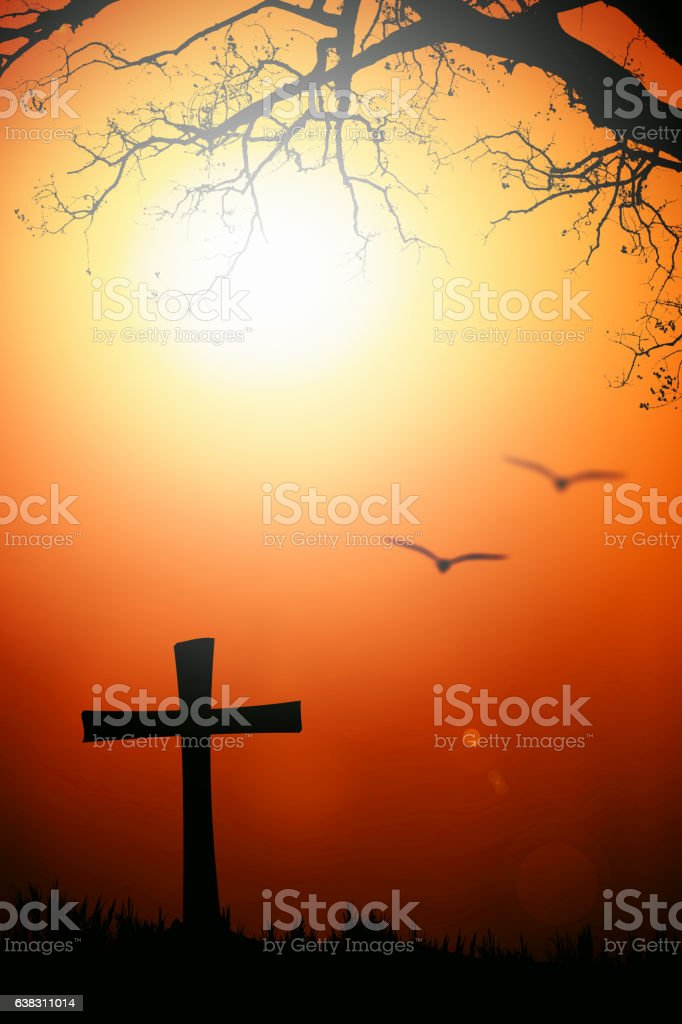 Silhouette of cross and tree with blurred bird with flare stock photo