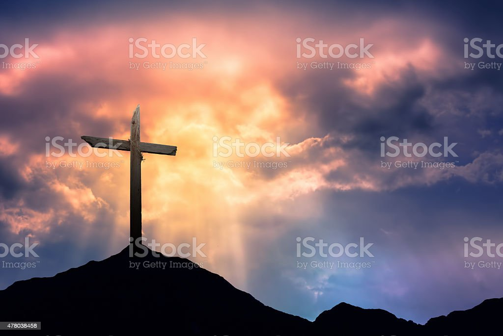 Silhouette of Cross at Sunrise stock photo