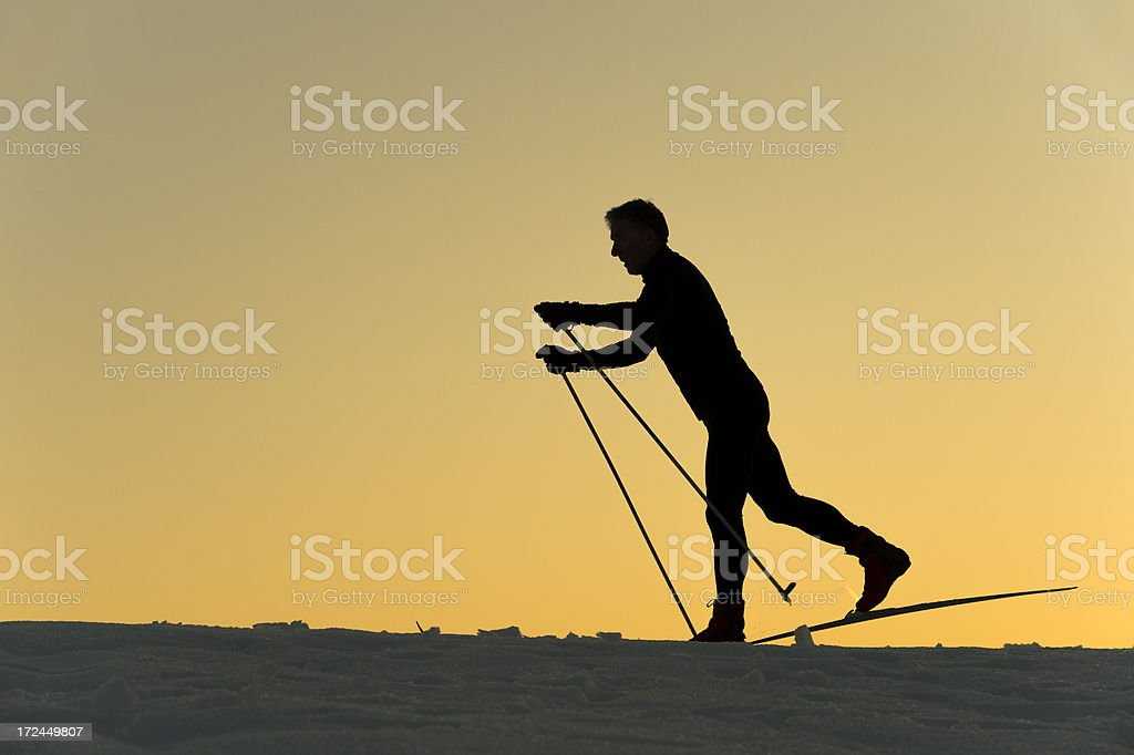 Silhouette of cross country skier at sunset royalty-free stock photo