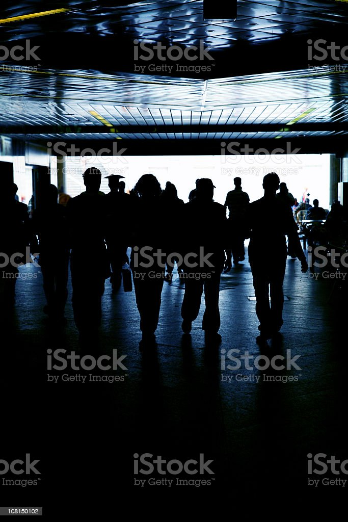 Silhouette of Crowd in Tunnel royalty-free stock photo