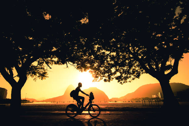 Silhouette of Cyclist in Rio de Janeiro at Sunrise stock photo