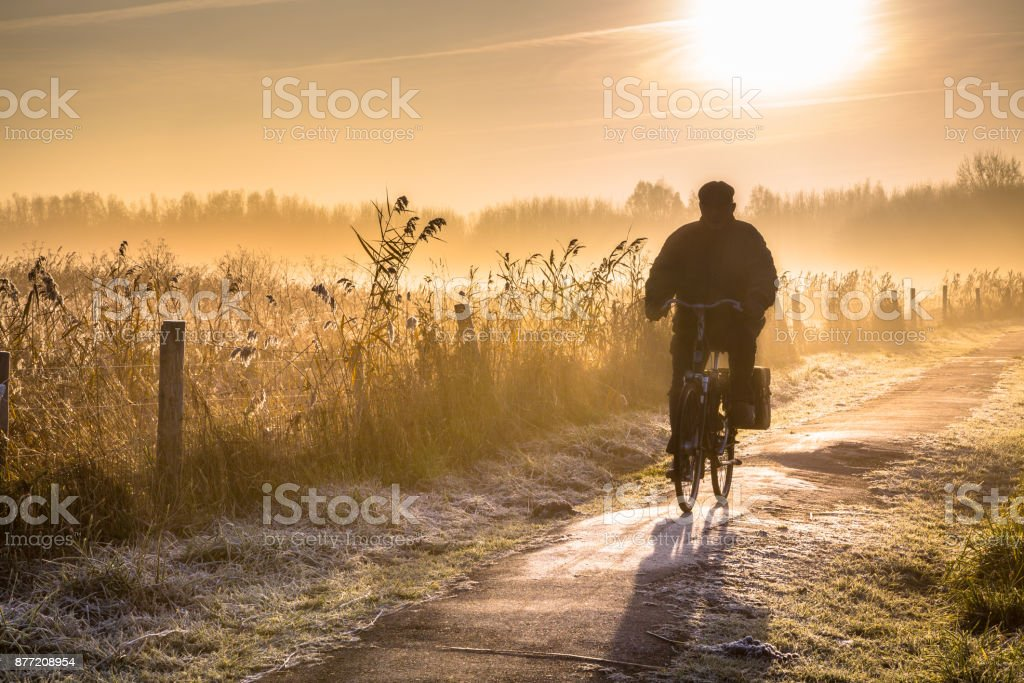 Silhouette of cyclist landscape stock photo