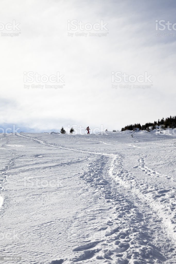 Silhouette of downhill snowboarder on snow off-piste slope in winter stock photo
