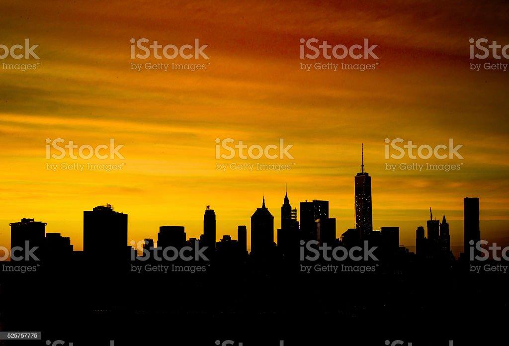 Silhouette of Downtown Manhattan skyline stock photo