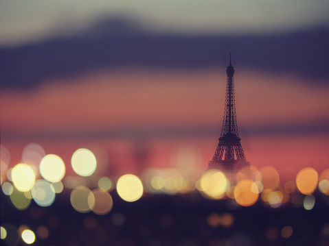 Silhouette of Eiffel tower and night lights of Paris, France