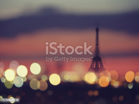 Silhouette of Eiffel tower and night lights of Paris, France. Vintage style travel backgroundSilhouette of Eiffel tower and night lights of Paris, France. Vintage style travel background