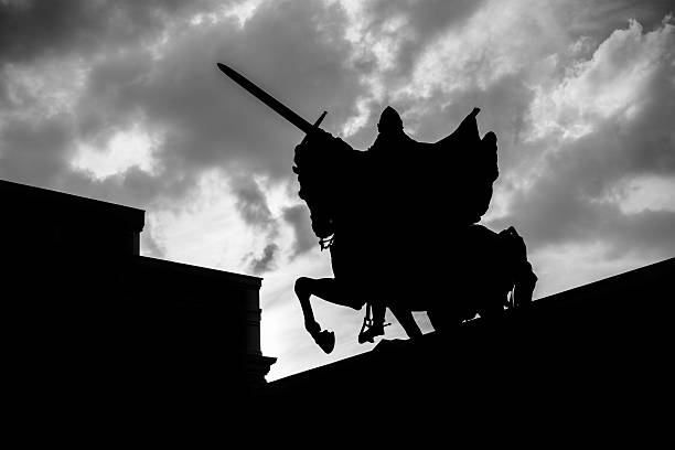 silhouette of el cid campeador in burgos - knight on horse stock photos and pictures