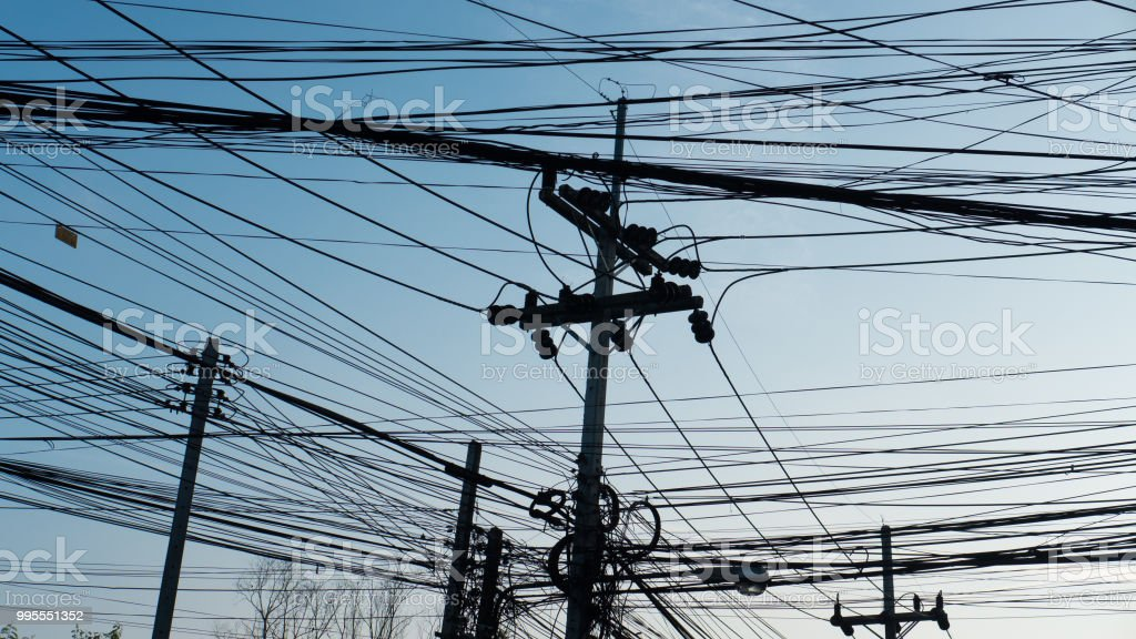 silhouette of Electric line in urban. Busy power cable on electric...
