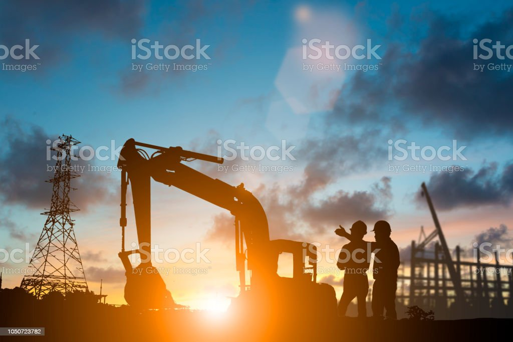 Silhouette of engineer and construction team working at site over blurred background for industry background with Light fair.Create from multiple reference images together stock photo