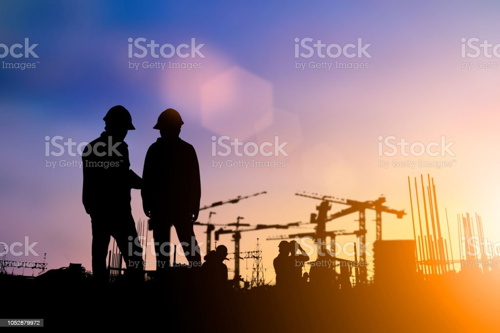 Silhouette of engineer and construction team working at site over blurred background for industry background with Light fair.Create from multiple reference images together Silhouette of engineer and construction team working at site over blurred background for industry background with Light fair.Create from multiple reference images together Architect Stock Photo