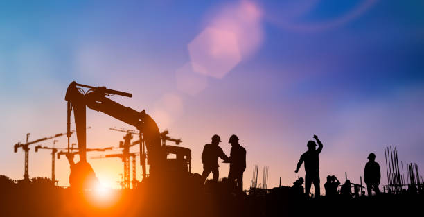 silhouette of engineer and construction team working at site over blurred background for industry background with light fair.create from multiple reference images together - obra imagens e fotografias de stock