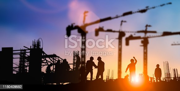 istock Silhouette of engineer and construction team working at site over blurred background for industry background with Light fair.Create from multiple reference images together 1150409552