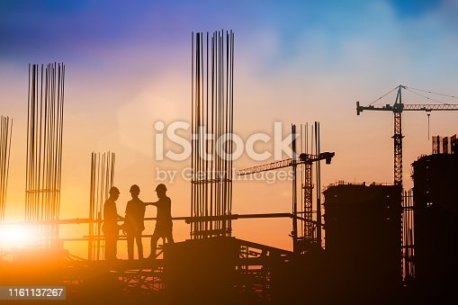 istock Silhouette of engineer and construction team working at site over blurred background for industry background with Light fair.Create from multiple reference images together 1161137267