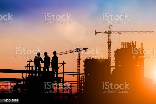 Silhouette of engineer and construction team working at site over picture id1162046065?b=1&k=6&m=1162046065&s=612x612&h=rr xjhp3aqcfiyoguzerruiann3zvz7e6i3nz fclme=