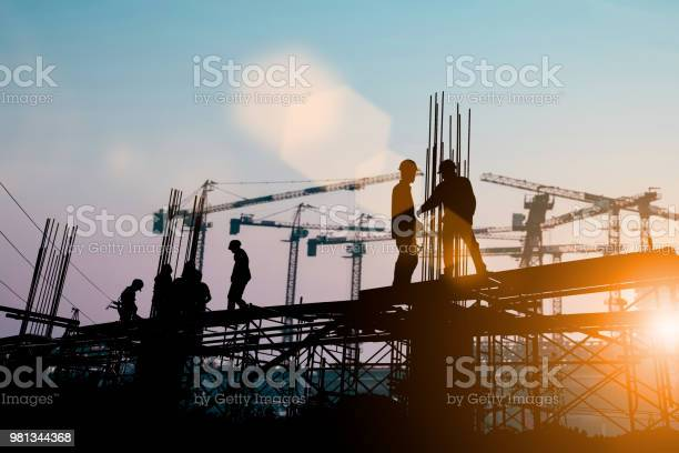 Silhouette of engineer and construction team working at site over picture id981344368?b=1&k=6&m=981344368&s=612x612&h=avsc sdhko8xitcxc24lg27bklk7obaa ug1pvwt qu=
