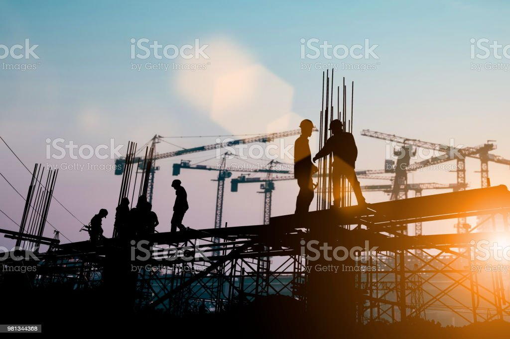 Silhouette of engineer and construction team working at site over blurred background sunset pastel for industry background with Light fair.Create from multiple reference images together. – zdjęcie