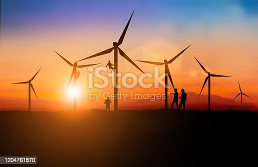 612720768 istock photo Silhouette of engineer and construction team working Maintenance of wind turbines is a clean energy that is widely used today. over blurred background sunset pastel for industry background with Light fair. 1204761870