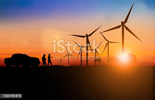 612720768 istock photo Silhouette of engineer and construction team working Maintenance of wind turbines is a clean energy that is widely used today. over blurred background sunset pastel for industry background with Light fair. 1204761873