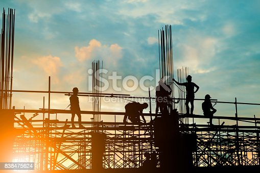 istock Silhouette of engineer and construction team working safely on scaffolding on high rise building. over blurred background sunset pastel for industry background with Light fair 838475624