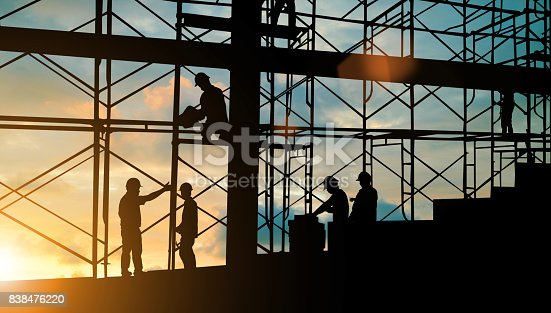 istock Silhouette of engineer and construction team working safely on scaffolding on high rise building. over blurred background sunset pastel for industry background with Light fair 838476220