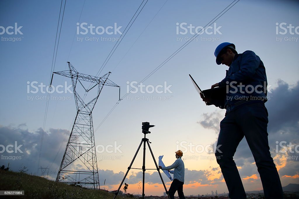 Silhouette of engineers workers at electricity station. stock photo