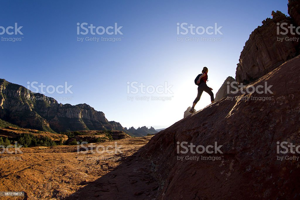 Silhouette of female hiker in Sedona stock photo