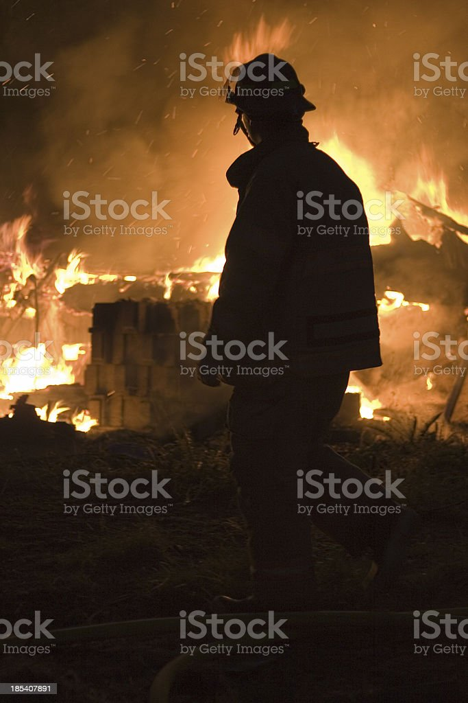 Silhouette of firefighter royalty-free stock photo