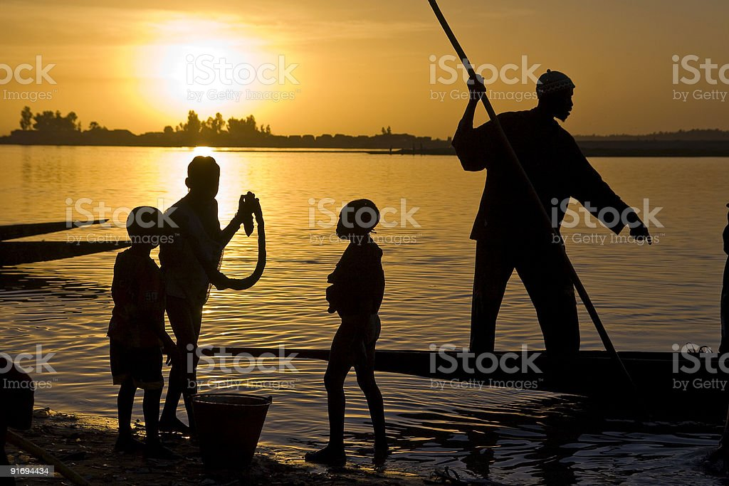 Silhouette of fisherman on Niger river stock photo