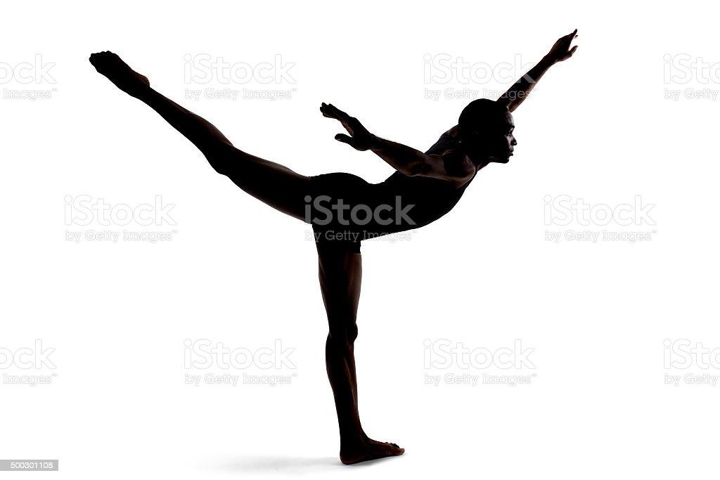 Silhouette of Flexible Male Dancer stock photo
