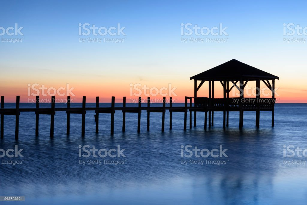 Silhouette of Gazebo and Fishing Pier at Sunset - Royalty-free Beauty In Nature Stock Photo