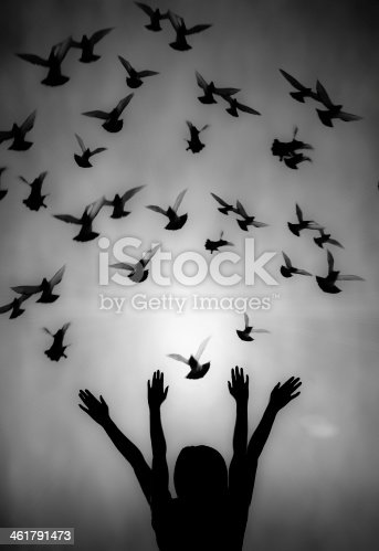 istock Silhouette of girl and dove 461791473