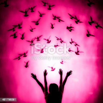 istock Silhouette of girl and dove 461796061
