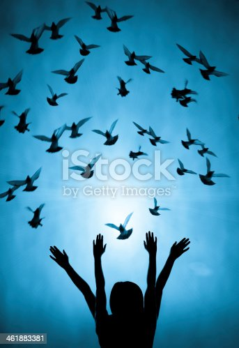 istock Silhouette of girl and dove 461883381