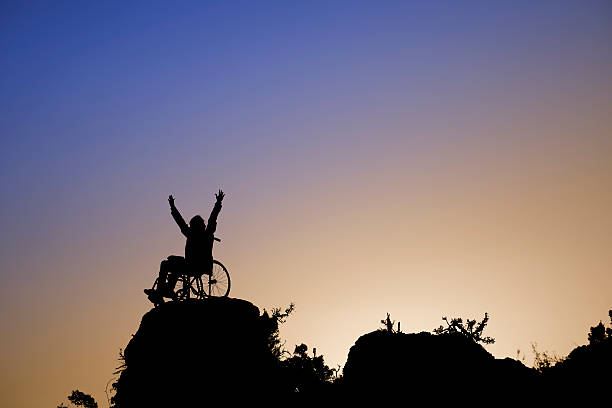 silhouette of girl on a wheelchair - wheelchair sports stock photos and pictures