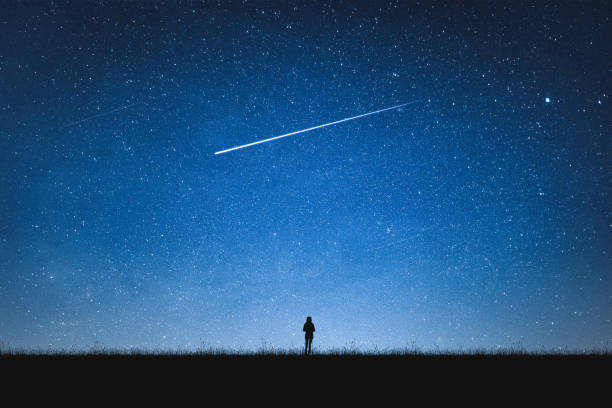 silhouette of girl standing on mountain and night sky with shooting star. alone concept. - stars imagens e fotografias de stock