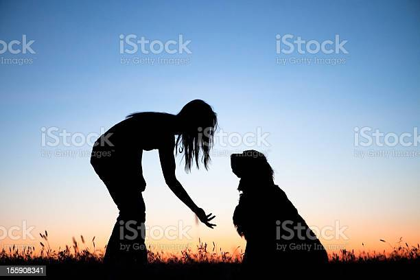 Silhouette of girl trying to get her dog to shake picture id155908341?b=1&k=6&m=155908341&s=612x612&h=nbidf2xk7g jk17bikareeq1ffmggpggh xyrz97wts=