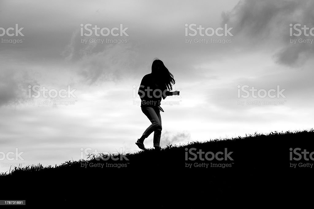 Silhouette of Girl Turning stock photo