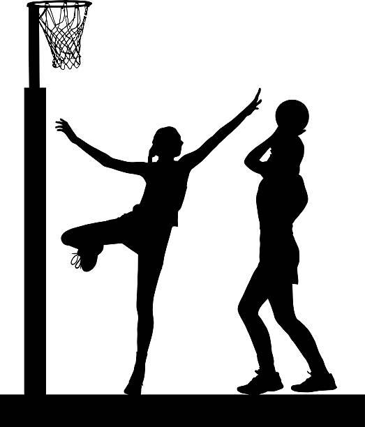 silhouette of girls ladies netball players jumping and blocking - netball stockfoto's en -beelden