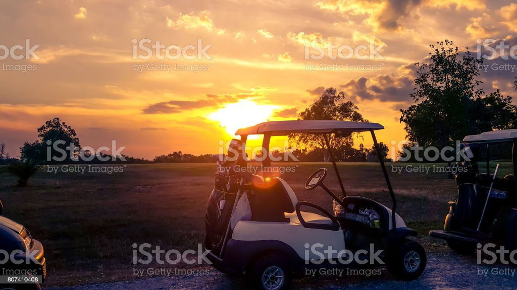 Silhouette of golf carts in Thailand golf course stock photo