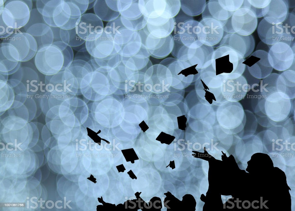 Silhouette Of Graduate Students Throw Mortarboards In