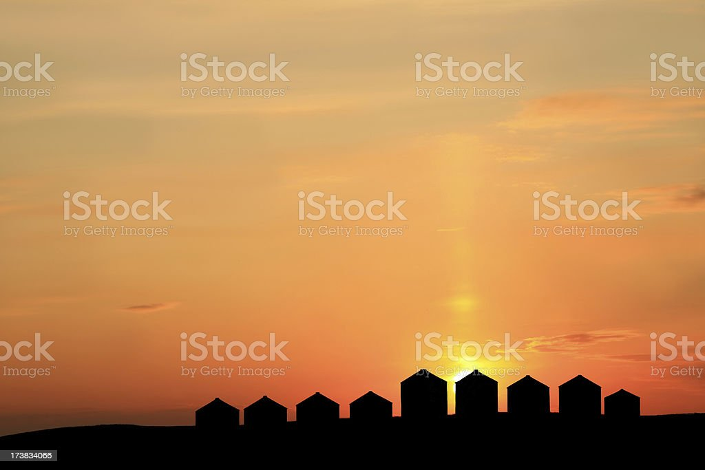 Silhouette of Granaries on the Prairie royalty-free stock photo
